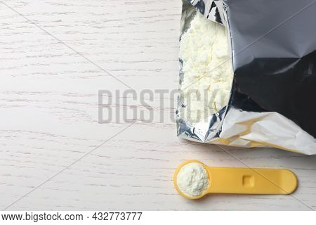 Bag Of Powdered Infant Formula, Scoop And Space For Text On White Wooden Table, Flat Lay. Baby Milk