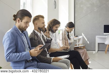 Group Of Young People Waiting In Line For A Job Interview Or Business Appointment