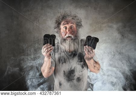Crazy man with beard holding burned toasted bread surrounded by  smoke
