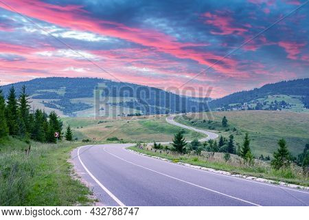 Curvy mountain road serpentine in summer mountains during sunset. Ukraine, Carpathian mountains. Landscape photography