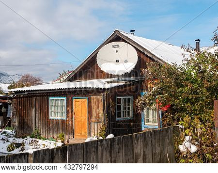 Chemal, Altai Republic, Russia - 15 October 2020: Russian Village Chemal In The Snow. Wooden House W