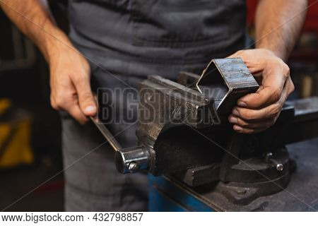 Close-up Hands Of Male Auto Mechanic In Dungarees With Work Tools Working At Car Service Station, In