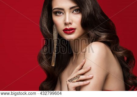Glamour Beauty Model Face Portrait. Luxury Young Woman With Perfect Red Lips Make Up And Curly Hair