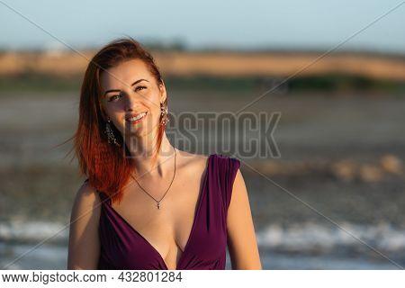 Beautiful Caucasian Woman Outdoor. Young Beautiful Smiling Woman Enjoying Sunlight. Pretty Red-haire