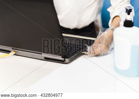 Hygiene Health Care Concept Man Hand With Gloves Insert Usb Flash Drive Into A Laptop.