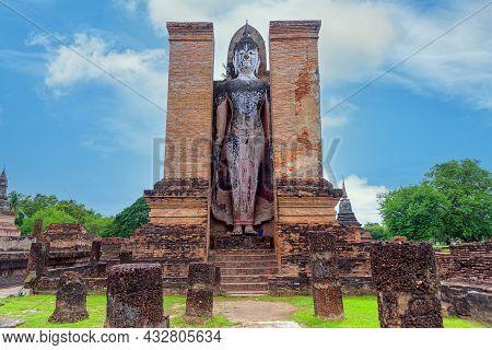 Ancient Buddha Statue At Sukhothai Historical Park, Unesco World Heritage Site In Thailand