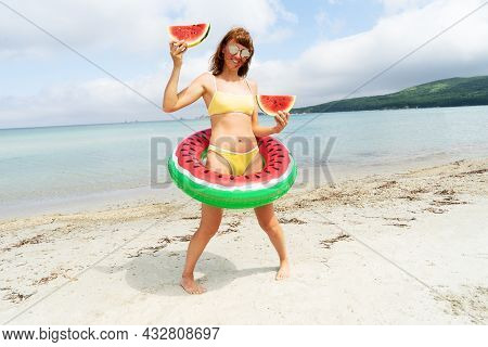 Funny Travel Woman In Swimsuit Posing With Lifebuoy Watermelon Slice At Paradise Beach Sea Resort
