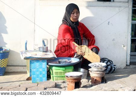 Portrait Of Indonesian Woman Selling Traditional Food. Location : Wonosobo, Central Java, Indonesia.