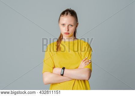 Portrait Of Sad Offended Teen Girl With Crossed Arms, Pouting Lips, Having Offended Facial Expressio
