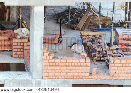 Kiev, Ukraine - June 22, 2018: The Workers Are Working On The Construction Site. Works On Laying A W