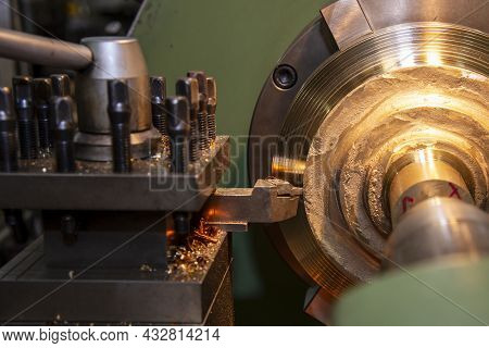 The Lathe Machine Rough Cutting The Brass Material Parts . The Metalworking Process By Turning Machi