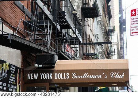 NEW YORK, NY, USA - APRIL 26, 2017: New York Dolls gentlemen s club entrance sign