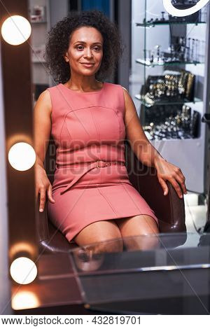 Positive Delighted Curly Haired Woman Being In Salon