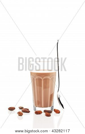 chocolate milk with chocolate beans and a standing spoon