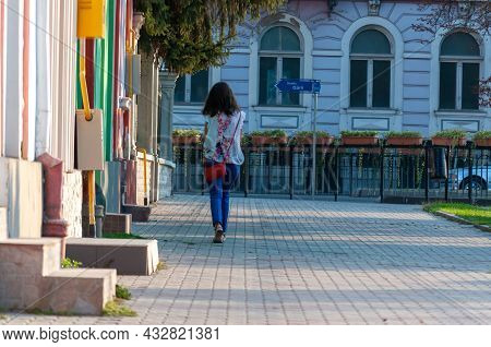 Bistrita, Romania - September 02, 2018: Woman Walking On The Street. Real People.