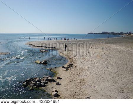 People On The Sandy Shore Of The Caspian Sea. Kazakhstan. Mangistau Region. 22 October. 2019 Year.