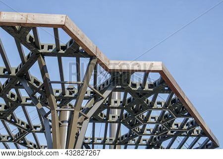 Pergola Canopy, Structural Elements. An Architectural Structure Of Repeating Arches To Protect Visit