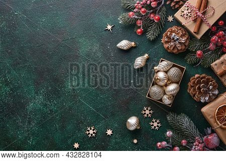 Christmas Fir Tree Branches, Christmas Balls, Gift Box, Wooden Snowflakes And Stars On Green Concret