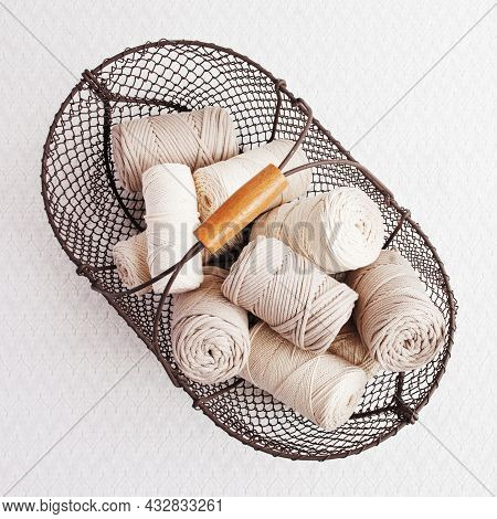 Handmade Macrame Braiding And Cotton Threads In Basket On White Background. Cotton Macrame Cords And