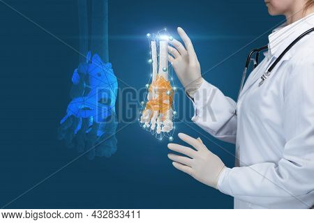 Ankle Diagnosis Treatment Concept. Doctor Examines Ankle Joint On Blue Background.