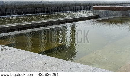 Cascade System Of Urban Fountains In The Main Square Of The City. A Modern Fountain In The City. Cit