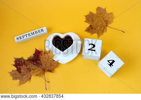Calendar For September 24 : The Name Of The Month In English, Cubes With The Number 24,a White Heart