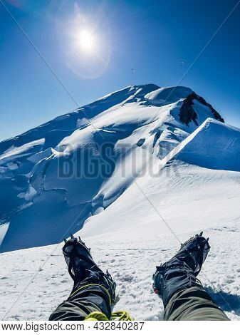 Climbing Last Steps Under Mont Blanc (monte Bianco) Summit 4,808m Snowy Slopes. Man's Legs In Boots