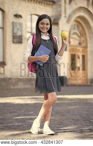 Smile Nicely And Eat Wisely. Happy Kid Hold Apple And Books. School Break. Nutrition Education. Brai