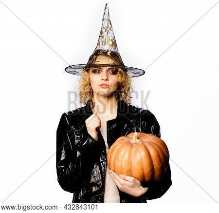 Happy Halloween. Sexy Girl Witch With Pumpkin. Traditional Food. Serious Woman In Witches Hat And Co
