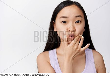 Silly Young Asian Woman Poking And Sqeezing Her Face, Pucker Lips Cute, Making Funny Adorable Facial