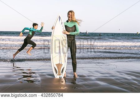Young Sexy Girl With Long Blonde Hairs, Smiling And Looking With Surf Board On The Beach In A Summer