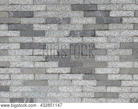 Masonry Of Small Long Gray Bricks Of Different Shades. Tile Pattern On The Roads. Road Surface
