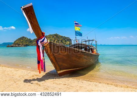 Thai Traditional Wooden Longtail Boat At Tropical Beach In Thailand