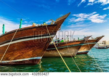 Old Cargo Wooden Arab Ships In The Port Of Deira On The Bay Creek In Dubai, United Arab Emirates