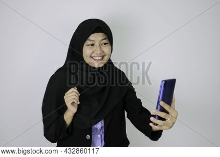 Smile Asian Islam Woman Wearing Headscarf When Video Call On Phone