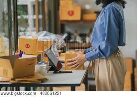 Business Woman Packing Parcel For Shipment. Online Business Owner Preparing Order And Shipping Box F