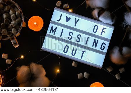 Lightbox With Text Jomo Joy Of Missing Out. The Concept Of Relaxation From Information And Gadgets.