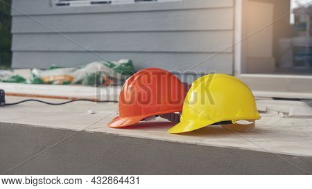 Safety Helmet (hard Hat) For Engineer, Safety Officer, Or Architect, Place On Cement Floor. Yellow A