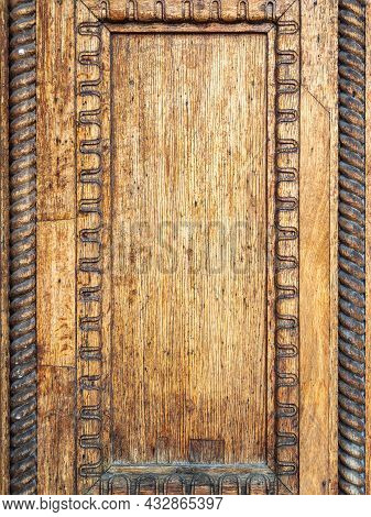 Fragment Of Wooden Door Of Old Building Of The 19th Century. Details Of Old Wooden Door With Rich Wo