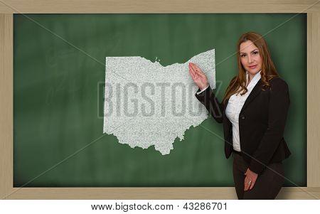 Teacher Showing Map Of Ohio On Blackboard