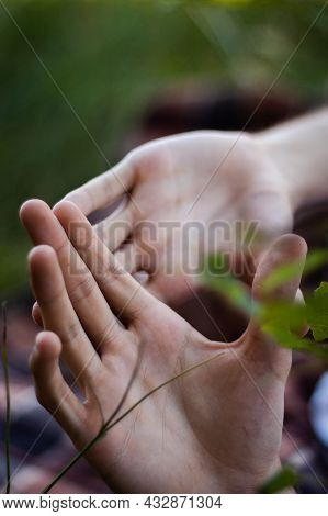 Laying Man Raising His Hands In A Defensive Gesture | Close Up Photo Of A Man Laying On A Ground And