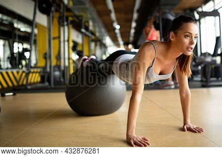 Fit Girl Workout With Fitness Ball In Gym. Sport Helath Fitness Lifestyle Concept