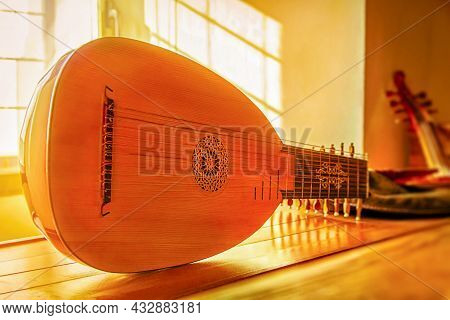 Soft Focus. Medieval Mandolin Close-up, Selective Focus In The Golden Glow From The Sun Rays From Th