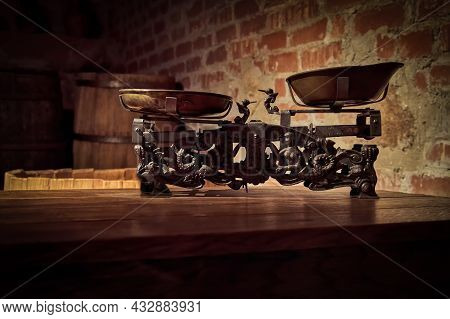 The Silhouette Of The Old Weight Scales In The Basement Of The Castle Against The Background Of A Br