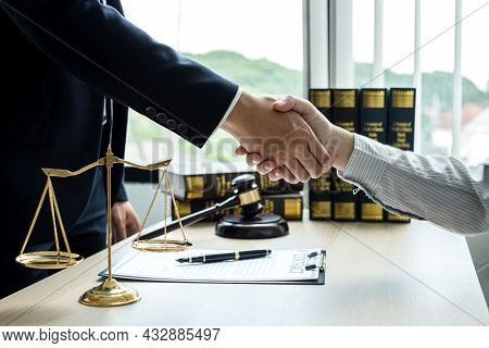 Shake Hand Professional Man Lawyers Work At A Law Office There Are Scales, Scales Of Justice, Judges