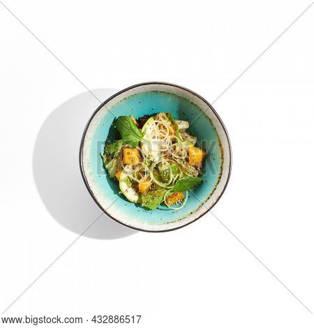 Fresh healthy food - green salad with avocado, mango. Vegetarian dish for restaurant on white background. Healthy organic vegan food. Healthy vegetarian lunch. Detox salad for diet. Eat less meat