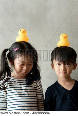 Japanese sibling playing together stock photo