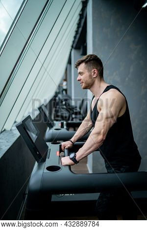 Healthy Lifestyle Athletic Male Running. Strong Young Man Running In The Gym.