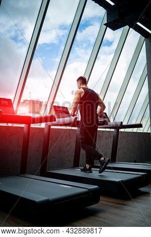 Strong Young Man Running In The Gym. Healthy Lifestyle Athletic Male Running.