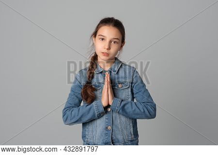 Preteen Girl Clasps Hands In Prayer, Begs For Favor, Needs Your Help In Difficult Situation, Looks D